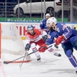 MINSK, BELARUS - MAY 20: France's Antonin Manavian #4 gets a pass off with pressure from Czech Republic's Michal Vondrka #82 during preliminary round action at the 2014 IIHF Ice Hockey World Championship. (Photo by Richard Wolowicz/HHOF-IIHF Images)